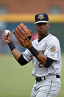 Left fielder Isiah Gilliam (25) of the Charleston RiverDogs warms up before a game against the Greenville Drive on Friday, July 28, 2017, at Fluor Field at the West End in Greenville, South Carolina. Charleston won, 6-1. (Tom Priddy/Four Seam Images)