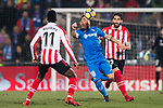 Mauro Wilney Arambarri Rosa of Getafe CF (C) fights for the ball with Inaki Williams Arthuer of Athletic Club de Bilbao (L) and Raul Garcia Escudero of Athletic Club de Bilbao (R) during the La Liga 2017-18 match between Getafe CF and Athletic Club at Coliseum Alfonso Perez on 19 January 2018 in Madrid, Spain. Photo by Diego Gonzalez / Power Sport Images