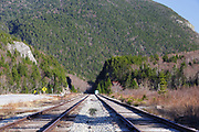 "Railroad tracks next to Crawford Train Depot (Conway Scenic Railroad) at the start of Crawford Notch in Carroll, New Hampshire along Route 302 in the New Hampshire White Mountains. The area straight ahead is referred to as ""the Gateway"", and the rock profile known as ""Elephant Head"" can be seen on the left."