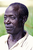 Ivory Coast, Cote d'Ivoire.  Burkinabe man (from Burkina Faso), showing facial scarification, traditionally used as a method of tribal identification.   This man from Burkina faso has come to Cote d'Ivoire for work.