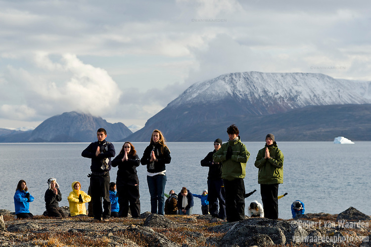 Students and expedition members from the Cape Farewell Youth Expedition preform a dance on the Arctic tundra. The students are part of the Cape Farewell Youth Expedition that was organized by the British Council of Canada. In the background, Baffin Island, Nunavut, Canada.