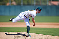 Oakland Athletics pitcher Wyatt Marks (56) follows through on his delivery during an Instructional League game against the Cincinnati Reds on September 29, 2017 at Lew Wolff Training Complex in Mesa, Arizona. (Zachary Lucy/Four Seam Images)