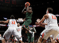CHARLOTTESVILLE, VA- JANUARY 7: Malcolm Grant #3 of the Miami Hurricanes shoots between Virginia Cavalier defenders during the game on January 7, 2012 at the John Paul Jones Arena in Charlottesville, Virginia. Virginia defeated Miami 52-51. (Photo by Andrew Shurtleff/Getty Images) *** Local Caption *** Malcolm Grant