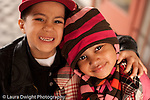 Preschool  3-5 year olds portrait of two friends boy and girl outside the  school wearing winter clothing horizontal