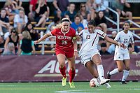 NEWTON, MA - AUGUST 29: Jade Ruiters #13 of Boston College passes the ball as McKenna Kennedy #26 of Boston University  pressures during a game between Boston University and Boston College at Newton Campus Field on August 29, 2019 in Newton, Massachusetts.