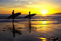 Couple enjoy a West Maui sunset after a surf session. Ka Puali, Maui.