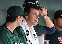 Pitchers Brandon Workman (32), left, and Anthony Ranaudo (23) of the Greenville Drive talk in the dugout during a game against the Augusta GreenJackets on April 10, 2011, at Fluor Field at the West End in Greenville, South Carolina. (Tom Priddy / Four Seam Images)