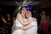 Daughter hugging her mother during her wedding celebrations.