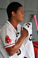 Starting pitcher Daniel Gonzalez (47) of the Greenville Drive in the dugout during a game against the Columbia Fireflies on Thursday, April 21, 2016, at Fluor Field at the West End in Greenville, South Carolina. Columbia won, 13-9. (Tom Priddy/Four Seam Images)