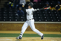 Gavin Sheets (24) of the Wake Forest Demon Deacons follows through on his swing against the Kent State Golden Flashes in game two of a double-header at David F. Couch Ballpark on March 4, 2017 in Winston-Salem, North Carolina.  The Demon Deacons defeated the Golden Flashes 5-0.  (Brian Westerholt/Four Seam Images)