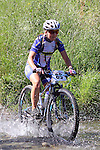 Jackqui Keay (88)  crosses the first ford. Mammoth Adventure MTB Ride, Nelson<br /> Photo: Marc Palmano/shuttersport.co.nz