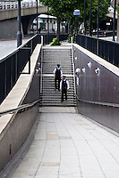 Police officers on foot patrol Edgware road walking the underpass to ensure safety for other pedestrians..