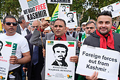 Kashmiris protest outside Parliament following India's actions in Indian-controlled Kashmir.  Muhammad Maqbool Bhat, Kashmiri separatist and founder of the National Liberation Front, was hanged in1984 in Tihar Jail in New Delhi.  Westminster, London.