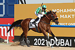 March 27, 2021: SECRET AMBITION #12 ridden by Tadhg O'Shea wins The Group 2 Godolphin Mile for Satish Seemar on Dubai World Cup Day, Meydan Racecourse, Dubai, UAE. Shamela Hanley/Eclipse Sportswire/CSM