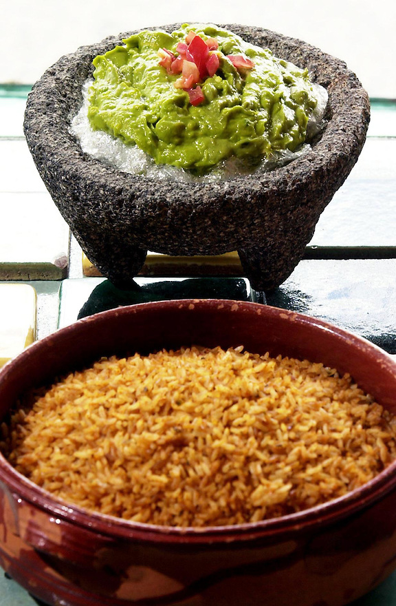 Fairfield_042302_Ole Mole's avocado guacamole red rice. Kerry Sherck/Staff photo