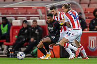 1st October 2021;  Bet365 Stadium, Stoke, Staffordshire, England; EFL Championship football, Stoke City versus West Bromwich Albion; Karlan Grant of West Bromwich Albion under pressure from  Ben Wilmot of Stoke City
