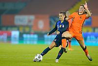 BREDA, NETHERLANDS - NOVEMBER 27: Aniek Nouwen #2 of the Netherlands battles Alex Morgan #13 of the United States during a game between Netherlands and USWNT at Rat Verlegh Stadion on November 27, 2020 in Breda, Netherlands.