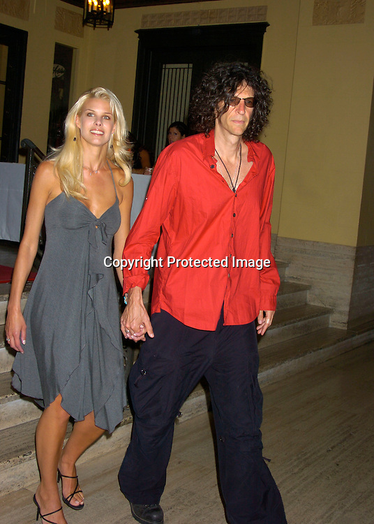 Beth Ostrowsky and Howard Stern ..at George Lang's 80th Birthday at Cafe des Artistes on ..June 15, 2004 in New York City. City Meals-on-..Wheels and City Harvest are benefiting from the evening. ..George Lang owns Cafe des Artistes. ..Photo by Robin Platzer, Twin Images