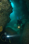 The Cavern leads to a keyhole feature and in turn the open reef at around 35m depth. Divers use torches to explore the interior. This image was taken prior to the MV Rena wrecking on Astrolabe Reef in 2011. It is understood that the weight of the Rena has damaged this geological feature and popular dive site.