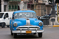 Cuba, Havana.  American Cars from the 1950s provide taxi service around Havana.  This is a Pontiac from around 1950.