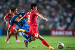 (R) Deshuai Xu of Hong Kong competes for the ball with (L) Leonel Vangioni of Argentina during the HKFA Centennial Celebration Match between Hong Kong vs Argentina at the Hong Kong Stadium on 14th October 2014 in Hong Kong, China. Photo by Aitor Alcalde / Power Sport Images