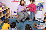 Education preschool 3-4 year olds circle time small group with female teacher, counting activity