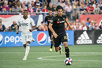 FOXBOROUGH, MA - AUGUST 3: Carlos Vela #10 of Los Angeles FC advances in the midfield with Luis Caicedo #27 of New England Revolution behind during a game between Los Angeles FC and New England Revolution at Gillette Stadium on August 3, 2019 in Foxborough, Massachusetts.