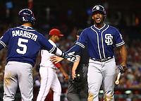 May 8, 2015; Phoenix, AZ, USA; San Diego Padres outfielder Justin Upton (right) celebrates with shortstop Alexi Amarista after scoring against the Arizona Diamondbacks at Chase Field. The Padres defeated the Diamondbacks 6-5. Mandatory Credit: Mark J. Rebilas-USA TODAY Sports