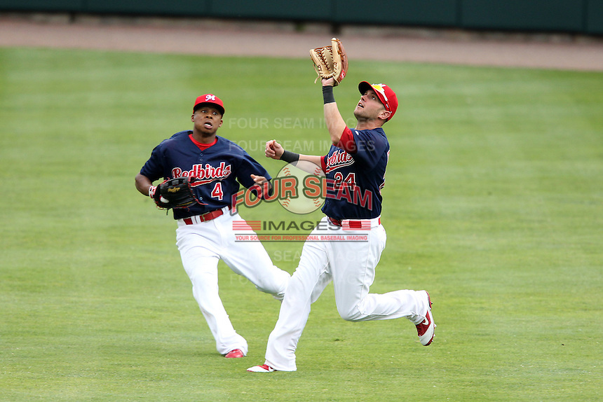 Memphis Redbirds outfielder Andrew Brown #24 catches a fly ball as Adron Chambers #4 backs up during a game versus the Round Rock Express at Autozone Park on April 30, 2011 in Memphis, Tennessee.  Memphis defeated Round Rock by the score of 10-7.  Photo By Mike Janes/Four Seam Images