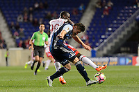 Harrison, NJ - Wednesday Feb. 22, 2017: Bradley Wright-Phillips, Jake Nerwinski during a Scotiabank CONCACAF Champions League quarterfinal match between the New York Red Bulls and the Vancouver Whitecaps FC at Red Bull Arena.