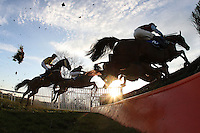 The field in jumping action during the PointToPoint.co.uk Hunters Chase - Horse Racing at Huntingdon Racecourse, Cambridgeshire - 23/02/12- MANDATORY CREDIT: Gavin Ellis/TGSPHOTO - Self billing applies where appropriate - 0845 094 6026 - contact@tgsphoto.co.uk - NO UNPAID USE.