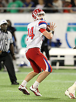 Manatee Hurricanes quarterback Cord Sandberg #24 looks to pass during the fourth quarter of the Florida High School Athletic Association 7A Championship Game at Florida's Citrus Bowl on December 16, 2011 in Orlando, Florida.  Manatee defeated First Coast 40-0.  (Mike Janes/Four Seam Images)