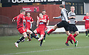 Shire's Michael McGowan scores their goal.