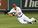 Josh Hamilton of the Los Angeles Angels makes a diving attempt to catch a line drive.
