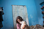 Dipmalya (Diya), plays with his dog whitey. Kolkata,  India. Arindam Mukherjee