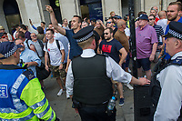 Anti fascists from Stand Up To Racism, Unite Against Fascism and the Anti Fascist Network protest against the far right 'Free Tommy - Welcome Trump' demonstration in Whitehall. Hundreds of Police kept the two sides apart though there were scuffles. 14-7-18 Far right Tommy Robinson supporters heckling the protest.