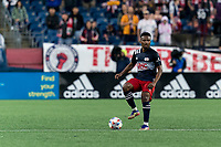 FOXBOROUGH, MA - AUGUST 4: Wilfrid Kaptoum #5 of New England Revolution looks to pass during a game between Nashville SC and New England Revolution at Gillette Stadium on August 4, 2021 in Foxborough, Massachusetts.