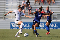 CARY, NC - SEPTEMBER 12: Natalia Kuikka #14 of the Portland Thorns FC and Cari Roccaro #21 of the North Carolina Courage challenge for the ball during a game between Portland Thorns FC and North Carolina Courage at Sahlen's Stadium at WakeMed Soccer Park on September 12, 2021 in Cary, North Carolina.