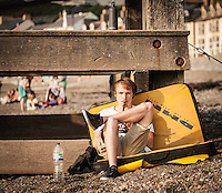 UK Weather: Aberystwyth, Ceredigion, West Wales <br />A man is relaxing on Aberystwyth beach.
