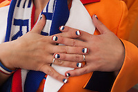 A Netherlands fans shows off her nails painted with the national flag  before the 2010 FIFA World Cup Final between Spain and Holland at a restaurant in Johannesburg, South Africa on Sunday, July 11, 2010.  Spain defeated Netherlands 1-0.