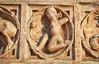 Medieval relief sculptures of mythical hunter on the exterior of the Romanesque Baptistery of Parma, circa 1196, (Battistero di Parma), Italy