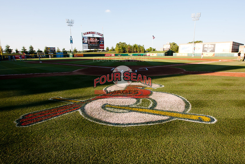 The Springfield Cardinals logo is seen behind home plate on Hammons Field prior to a game between the Midland RockHounds and the Springfield Cardinals at Hammons Field on July 11, 2011 in Springfield, Missouri. (David Welker / Four Seam Images)