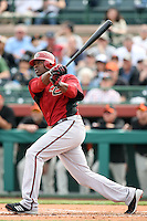 Justin Upton #10 of the Arizona Diamondbacks bats against the San Francisco Giants in the first spring training game of the season at Scottsdale Stadium on February 25, 2011  in Scottsdale, Arizona. .Photo by:  Bill Mitchell/Four Seam Images.