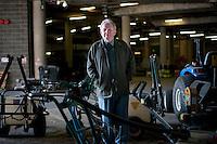 Eddie Seaward, Head Groundsman amongst machinery underneath No1 Court at Wimbledon, The All England Lawn Tennis Club (AELTC), London...