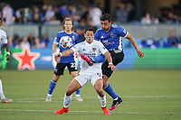 SAN JOSE, CA - JUNE 26: Chicharito #14 of the LA Galaxy is defended by Oswaldo Alanis #4 of the San Jose Earthquakes during a game between Los Angeles Galaxy and San Jose Earthquakes at PayPal Park on June 26, 2021 in San Jose, California.