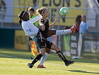 Danesha Adams (left) and Kimberly Yokers (right) battle for possession of the ball. FC Gold Pride and Chicago Red Stars tied 1-1 at Buck Shaw Stadium in Santa Clara, California on June 7, 2009.