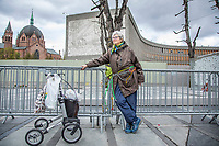 """After laying down some flowers 74 year old Tone Strand Muss chained herself to a fence to protest the demolition of the Y-block, the building in the background. The former government building contains work of Picasso and Nesjar and the planned demolition is very unpopular.<br /> <br /> In the late 1950s and the early 1970s the Spanish artist Pablo Picasso designed five murals (The Beach, The Seagull, Satyr and Faun and two versions of The Fisherman) for the Regjeringskvartalet ('Government quarter') buildings in central Oslo, Norway.<br /> <br /> The designs by Picasso were executed in concrete by Norwegian artist Carl Nesjar, and were Picasso's first attempt at monumental concrete murals<br /> <br /> The modernist building, the Y-block, which formed part of the Norwegian government quarter for over fifty years. <br /> <br /> The building was drawn by architect Erling Viksjø and was finished 1969. Following the 2011 terror attack the building was left empty while the government have been mulling its' options. <br /> <br /> A decision on the fate of the murals was expected in early 2014. The murals were subsequently listed as one of Europe's most endangered heritage sites in 2015 by the heritage organisation Europa Nostra following the Norwegian cabinet's vote to demolish the Y-block building.<br /> <br /> In the beginning of 2020 the Norwegian government decided to tear down the building and redevelop the goverment quarter. <br /> <br /> The Architect's Newspaper writes: <br /> """"Demolition-ready government officials have vowed to save and relocate the murals, which were executed by Picasso's frequent collaborator, the Norwegian artist Carl Nesjar. Preservationists near and far, however, are crying foul. They believe that the building itself should also be spared from the wrecking ball.""""<br /> <br /> <br /> ©Fredrik Naumann/Felix Features"""