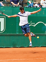 10-07-13, Netherlands, Scheveningen,  Mets, Tennis, Sport1 Open, day three, Lorenzo Giustino (ITA) jumps over the ball<br /> <br /> <br /> Photo: Henk Koster