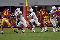LOS ANGELES, CA - SEPTEMBER 11: Nathaniel Peat #8 of the Stanford Cardinal runs with the ball with blocking by E.J. Smith #22 during a game between University of Southern California and Stanford Football at Los Angeles Memorial Coliseum on September 11, 2021 in Los Angeles, California.