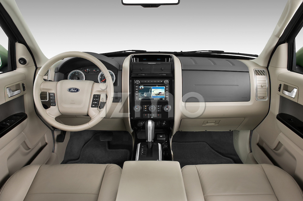 Straight dashboard view of a 2009 Ford Escape Hybrid.
